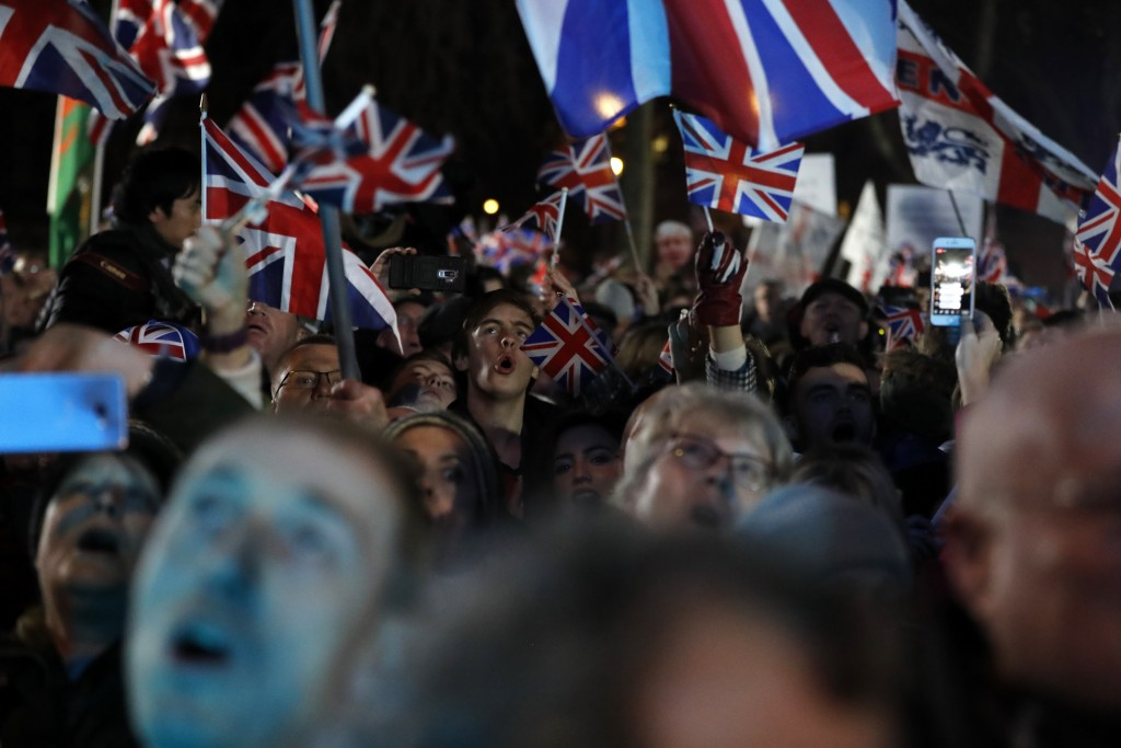 Brexit supporters celebrate during a rally in London, Friday, Jan. 31, 2020. Britain leaves the European Union after 47 years, leaping into an unknown...