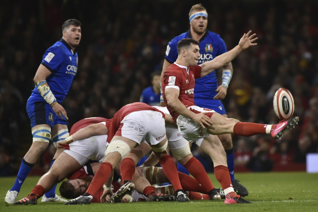 Wales' Tomos Williams clears the ball during the Six Nations rugby union international between Wales and Italy at the Principality Stadium in Cardiff,...