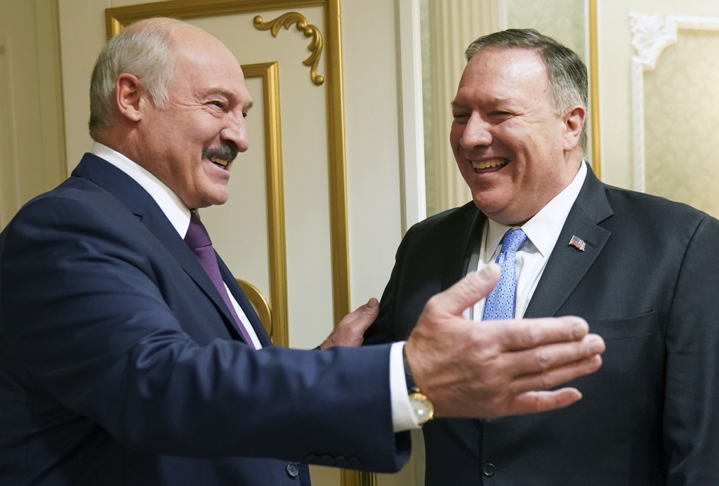 Belarusian President Alexander Lukashenko greets U.S. Secretary of State Mike Pompeo during a meeting in Minsk, Belarus, Saturday, Feb. 1, 2020. (Kevi...