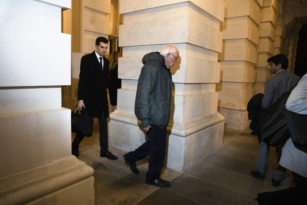 Democratic presidential candidate Sen. Bernie Sanders, I-Vt., leaves Capitol Hill in Washington, Friday, Jan. 31, 2020, after the Senate voted to not ...