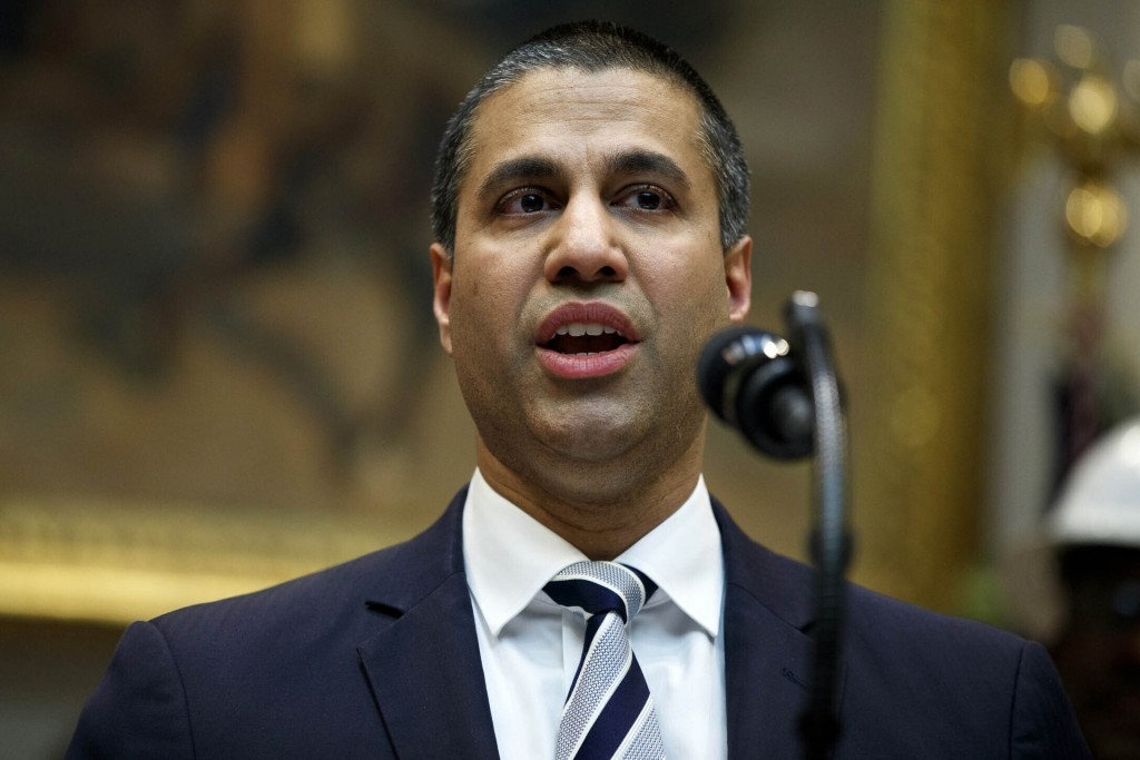 FILE - In this April 12, 2019 file photo, Federal Communications Commission Chairman Ajit Pai speaks during an event in Washington. U.S. phone compani...