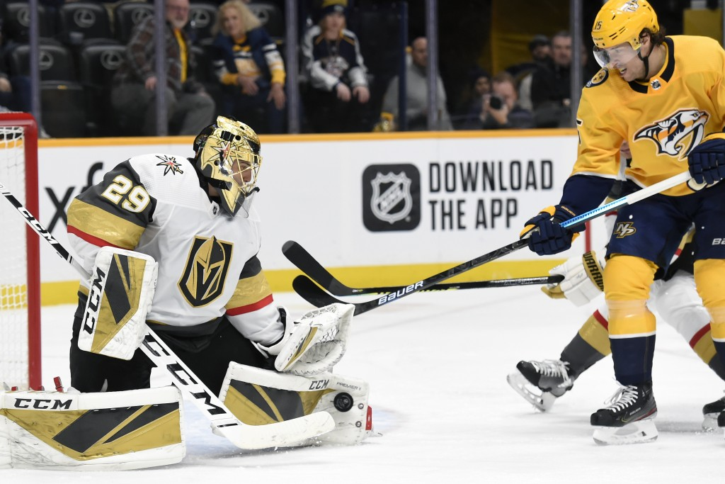 Vegas Golden Knights goaltender Marc-Andre Fleury (29) blocks a shot by Nashville Predators right wing Craig Smith (15) during the second period of an...