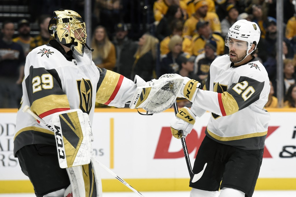 Vegas Golden Knights center Chandler Stephenson (20) is congratulated by goaltender Marc-Andre Fleury (29) after scoring against the Nashville Predato...