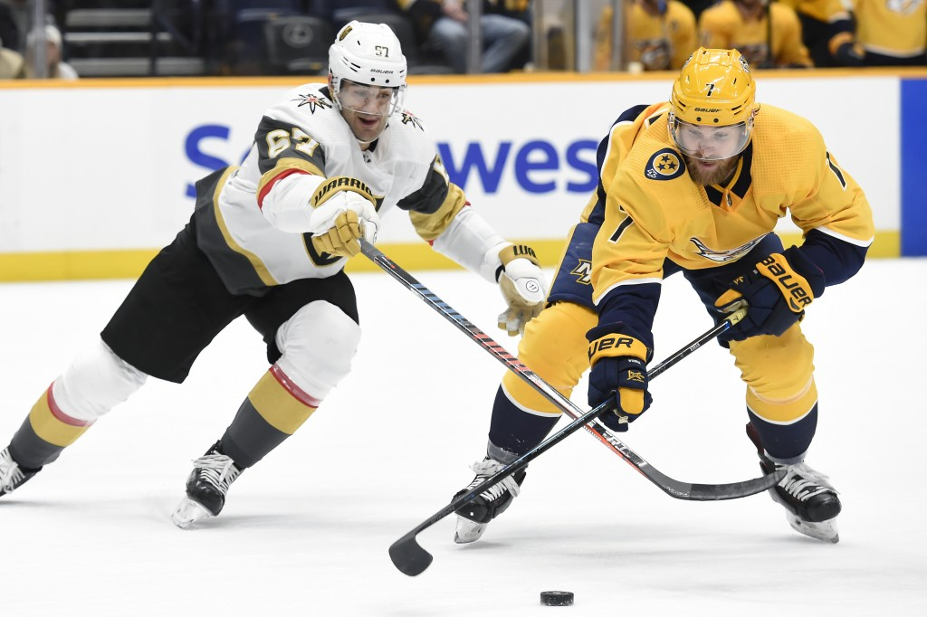Nashville Predators defenseman Yannick Weber (7), of Switzerland, gets control of the puck in front of Vegas Golden Knights left wing Max Pacioretty (...