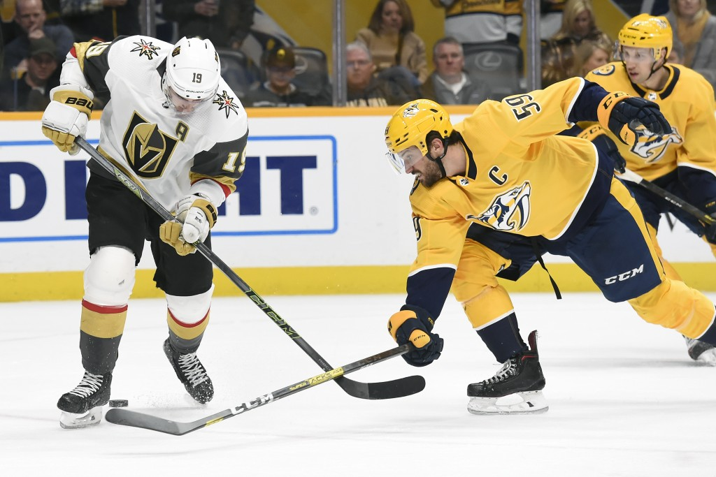 Nashville Predators defenseman Roman Josi (59), of Switzerland, pokes the puck away from Vegas Golden Knights right wing Reilly Smith (19) during the ...