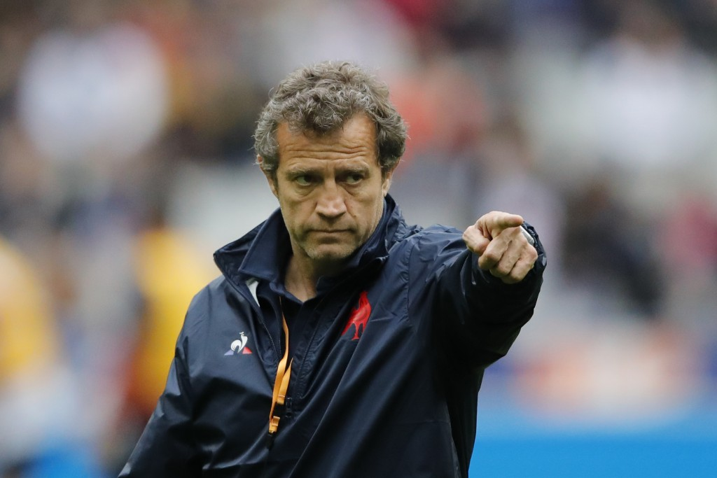 French head coach Fabien Galthie gestures to his players as they warm up prior to the start of the Six Nations rugby union international match between...