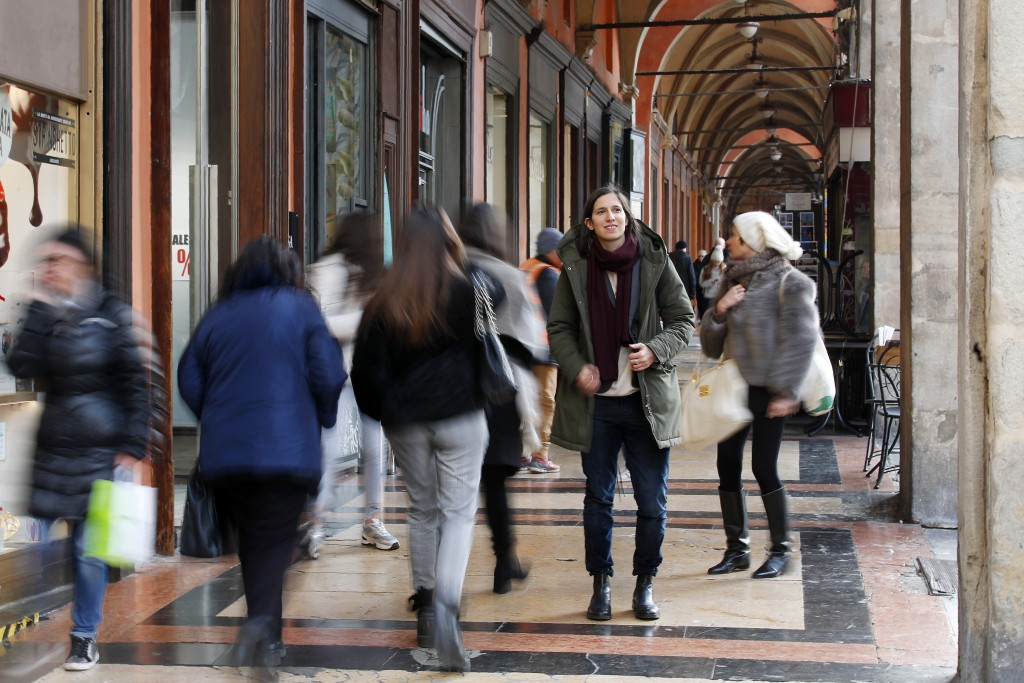 In this photo taken on Thursday, Jan. 30, 2020, Elly Schlein walks under a portico after an interview with the Associated Press, in downtown Bologna, ...