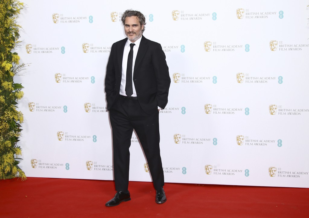 Actor Joaquin Phoenix poses for photographers upon arrival at the Bafta Nominees Party, in central London, Saturday, Feb. 1, 2020. (Photo by Joel C Ry...
