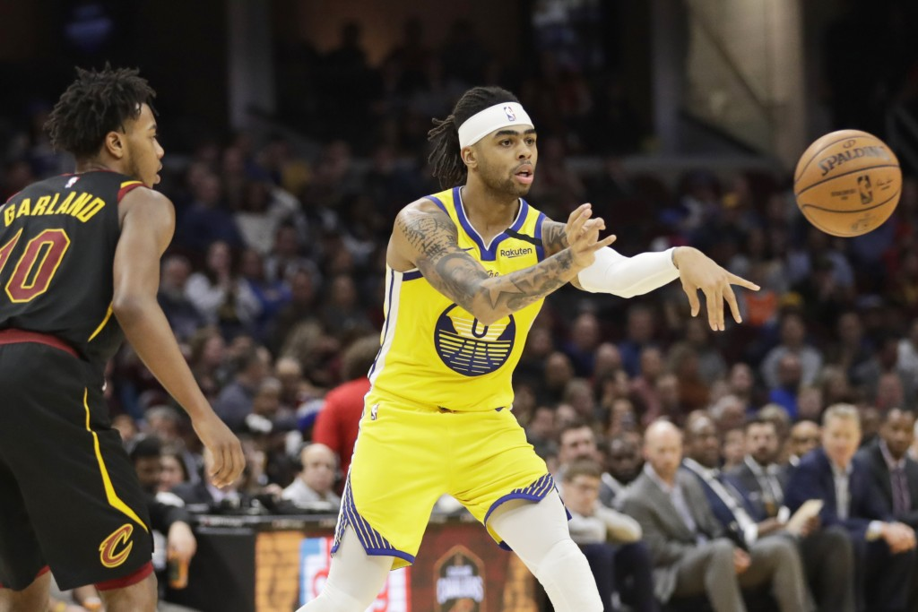 Golden State Warriors' D'Angelo Russell (0) passes as Cleveland Cavaliers' Darius Garland (10) watches in the second half of an NBA basketball game, S...