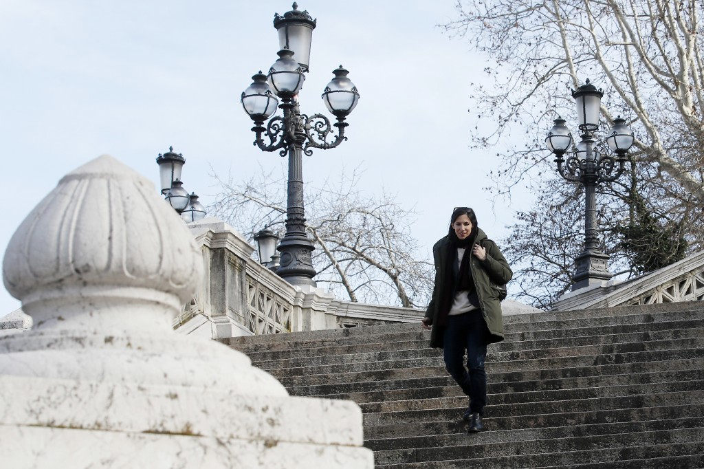 In this photo taken on Thursday, Jan. 30, 2020, Elly Schlein walks down steps after an interview with the Associated Press, in downtown Bologna, Italy...