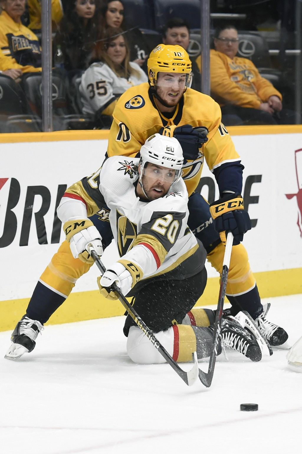 Vegas Golden Knights center Chandler Stephenson (20) passes the puck in front of Nashville Predators center Colton Sissons (10) during the first perio...