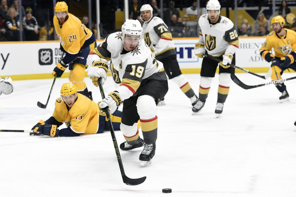 Vegas Golden Knights right wing Reilly Smith (19) moves the puck away from Nashville Predators center Nick Bonino (13) during the first period of an N...