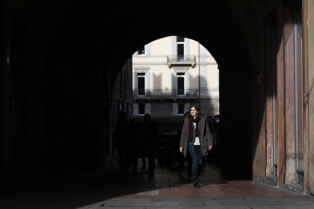 In this photo taken on Thursday, Jan. 30, 2020, Elly Schlein walks on a street after an interview with the Associated Press, in downtown Bologna, Ital...