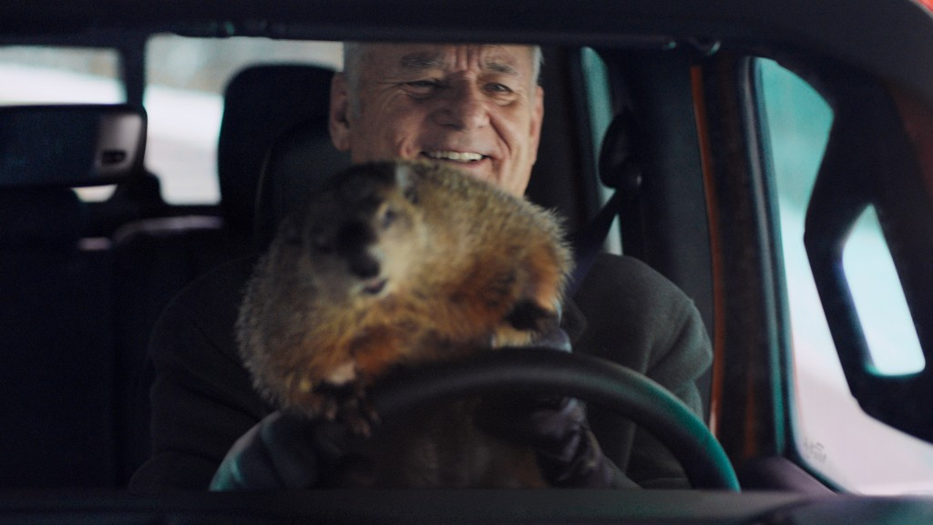 """This undated image provided by Jeep shows Bill Murray reprises his role as Phil Connors from the 1993 film """"Groundhog Day,"""" in a scene from the compan..."""