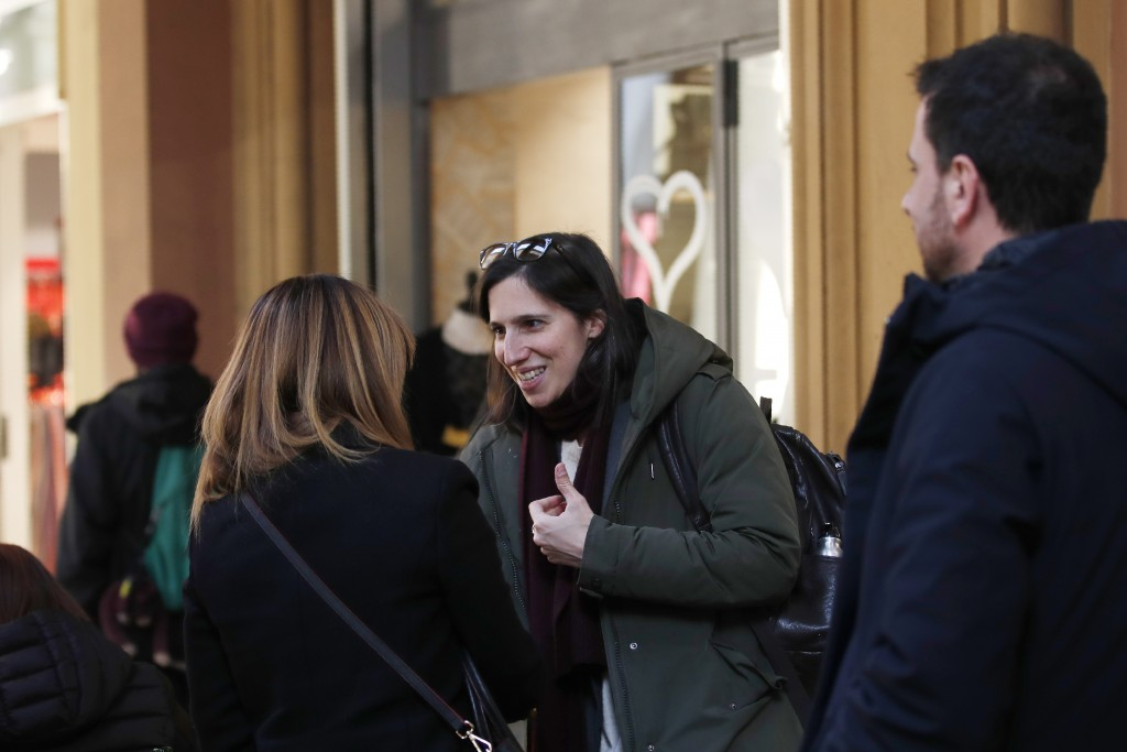 In this photo taken on Thursday, Jan. 30, 2020, Elly Schlein talks with people on a street after an interview with the Associated Press in downtown Bo...