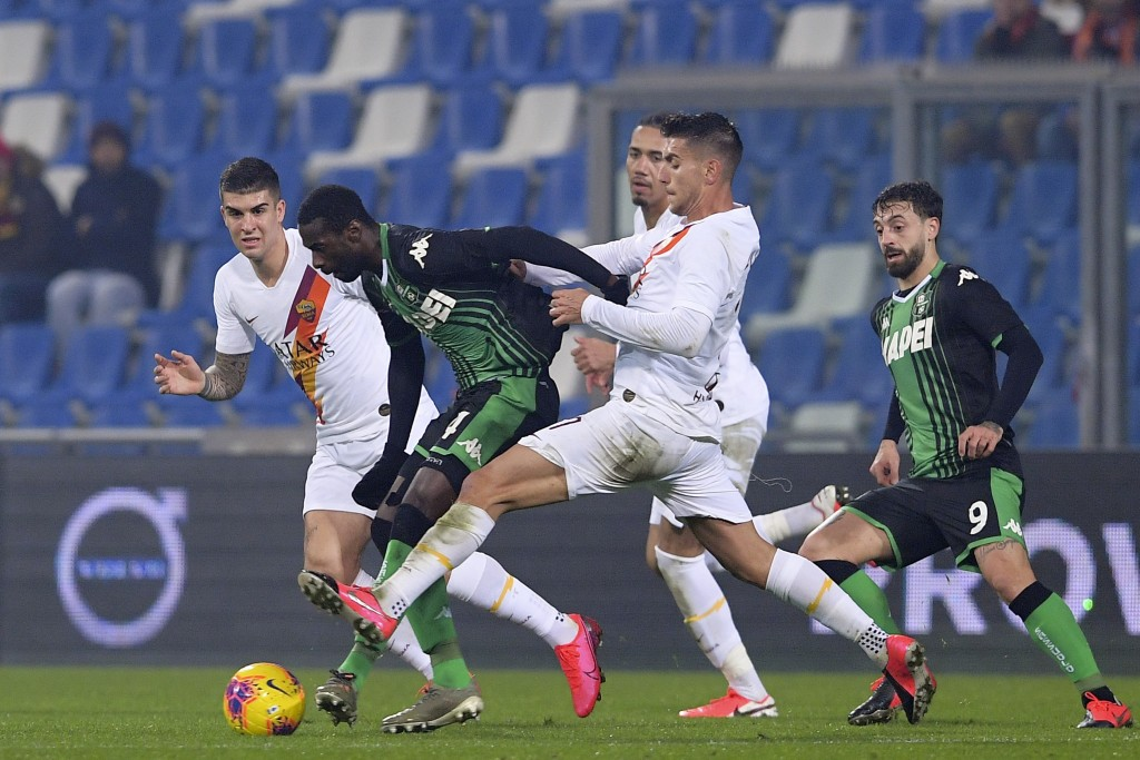 Roma's Lorenzo Pellegrini, and Sassuolo's Pedro Obiang vie for the ball, during a Serie A soccer match between Roma and Sassuolo, in Reggio Emilia, It...