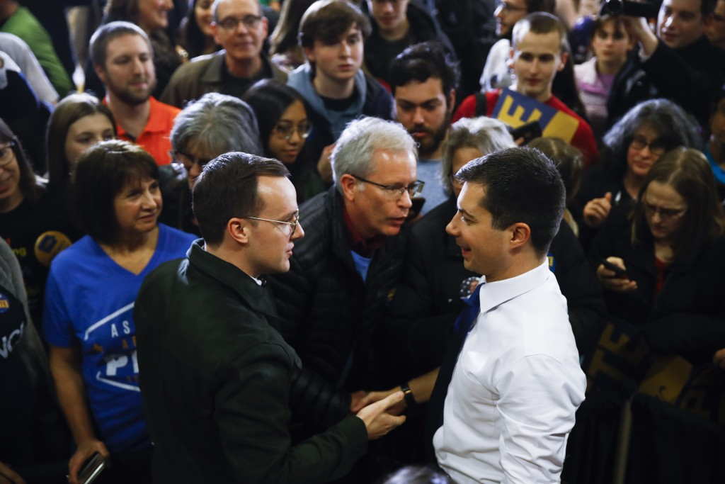 Democratic presidential candidate former South Bend, Ind., Mayor Pete Buttigieg, right, looks to his husband Chasten Buttigieg, left, as they meets me...