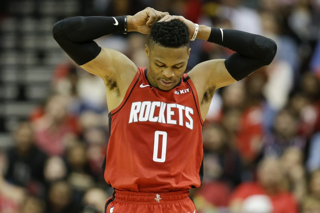 Houston Rockets guard Russell Westbrook reacts after turning the ball over during the first half of an NBA basketball game against the New Orleans Pel...