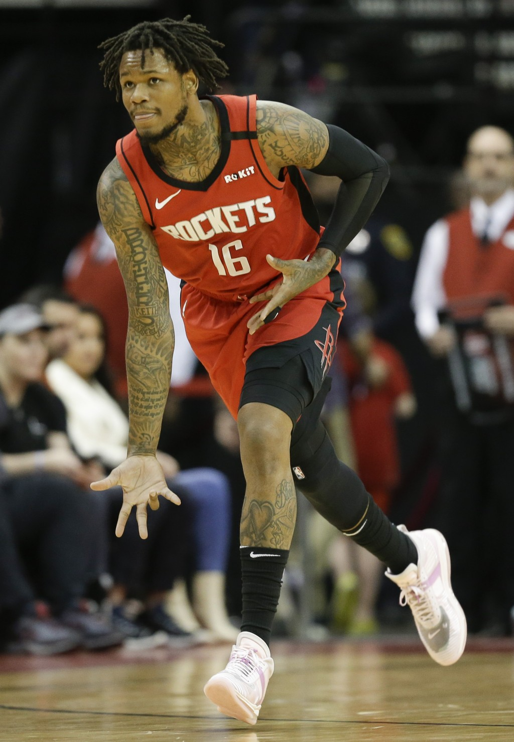 Houston Rockets guard Ben McLemore reacts after making a three-point basket during the first half of an NBA basketball game against the New Orleans Pe...