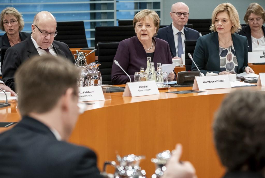 German Chancellor Angela Merkel, center, speaks alongside Peter Altmaier, Federal Minister of Economics and Energy, left, and Julia Klöckner, Federal ...