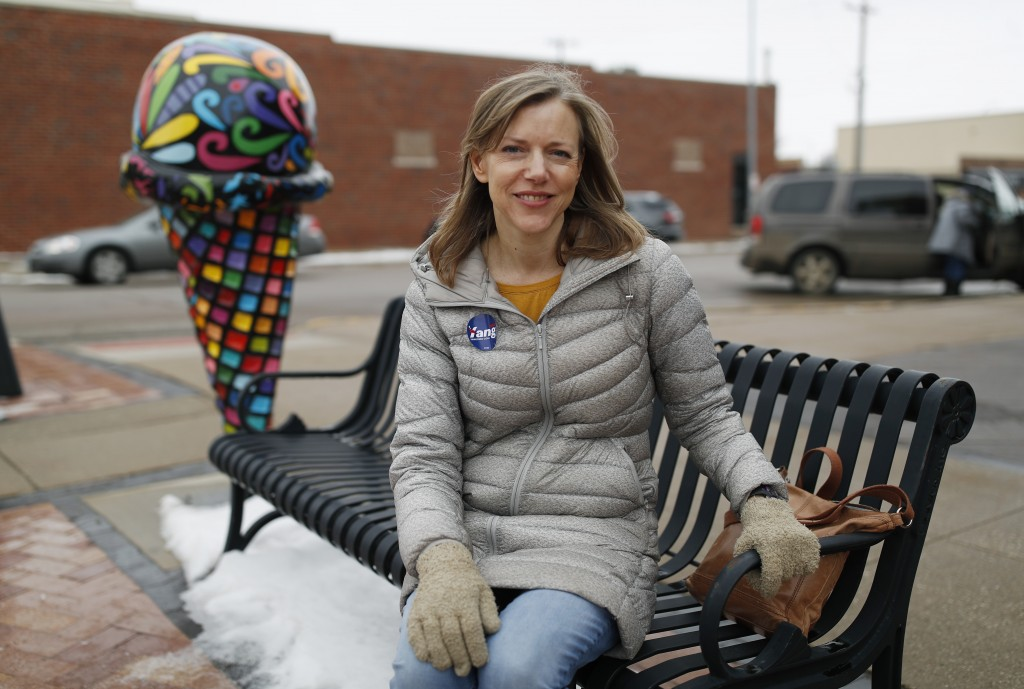 In this Jan. 27, 2020, photo, Mary Albrecht poses for a picture in Le Mars, Iowa. If Albrecht caucuses as a Democrat on Monday, Feb. 3, — and that's s...