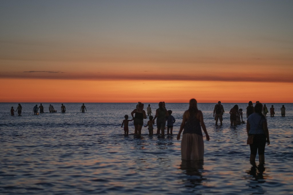 People enter the sea as they participate in a ritual to honor the African sea goddess Yemanja, at a beach in Montevideo, Uruguay, Sunday, Feb. 2, 2020...