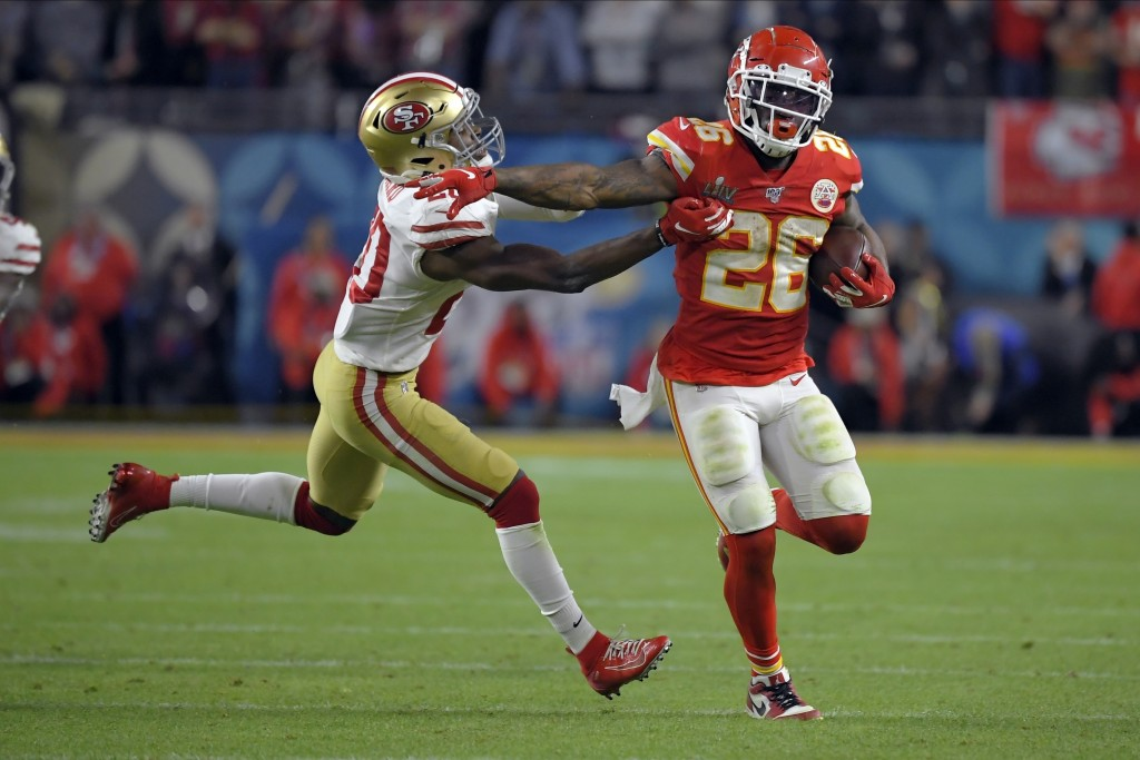 Kansas City Chiefs' Damien Williams, right, pulls away from San Francisco 49ers' Jimmie Ward on his way to the winning touchdown during the second hal...