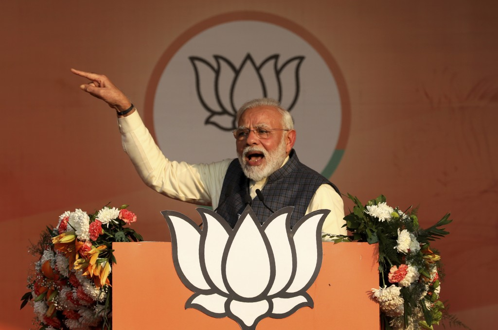 Indian Prime Minister Narendra Modi addresses his Bharatiya Janata Party's campaign rally ahead of Delhi state elections in New Delhi, India, Monday, ...
