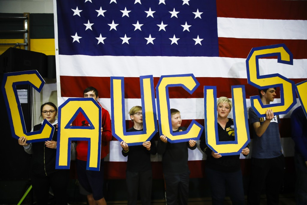 """Attendees hold letters that read """"CAUCUS"""" during a campaign event for Democratic presidential candidate former South Bend, Ind., Mayor Pete Buttigieg ..."""
