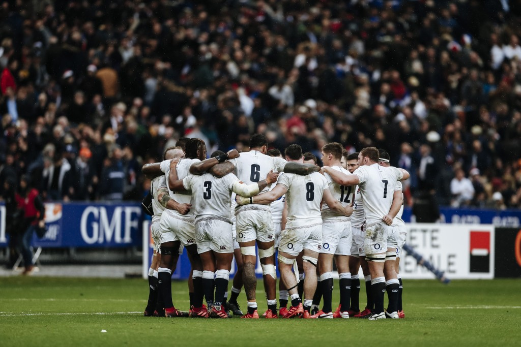 England rugby team huddle during the Six Nations rugby union international match between France and England at the Stade de France stadium, in Saint D...