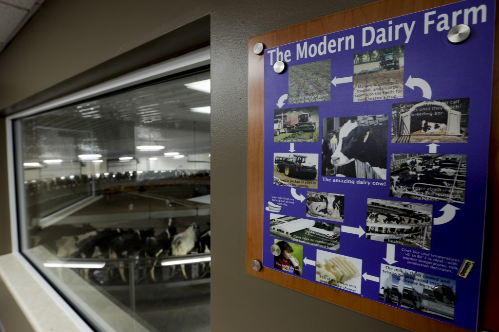 In this Dec. 4, 2019, photo an informational sign is seen at Rosendale Dairy in Pickett, Wis. At Rosendale Dairy, each of the 9,000 cows has a microch...