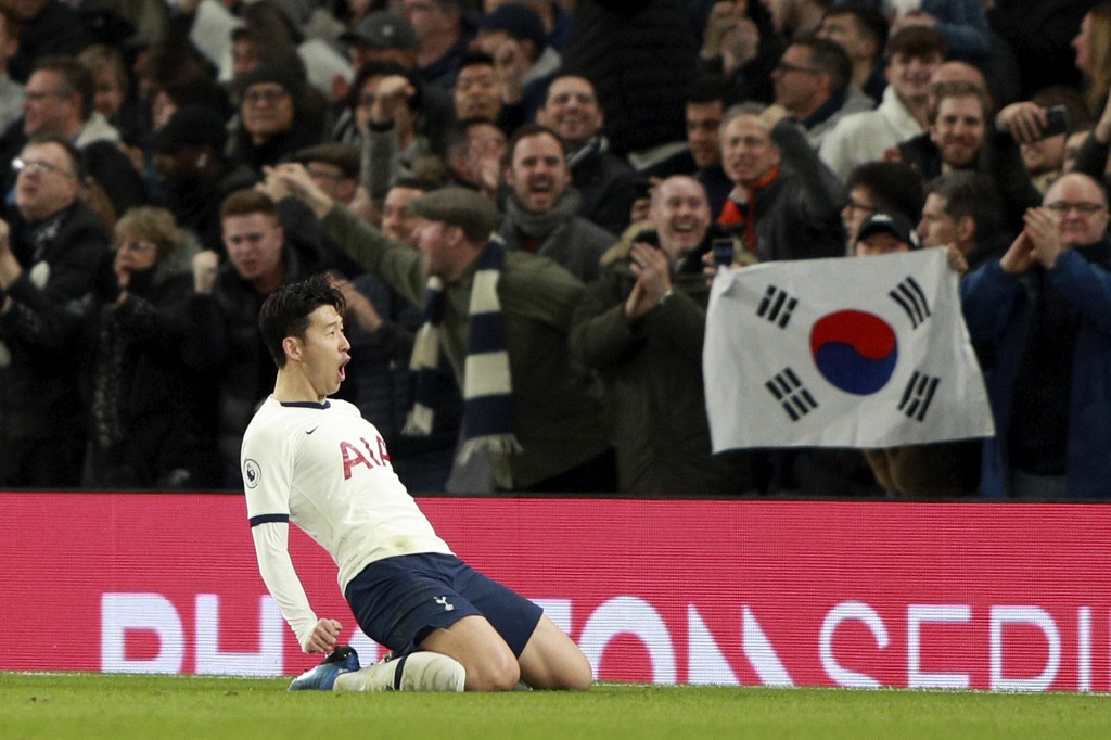 Tottenham's Son Heung-min celebrates after scoring his side's second goal during the English Premier League soccer match between Tottenham Hotspur and...