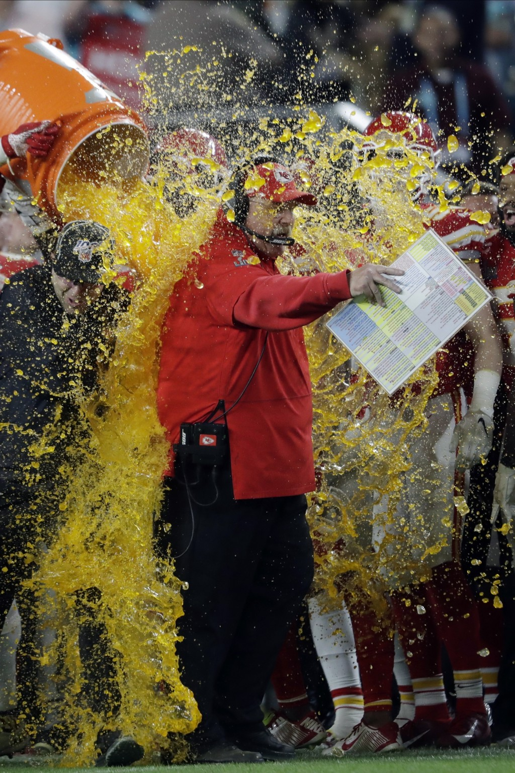 Kansas City Chiefs head coach Andy Reid is doused on the sideline during the second half of the NFL Super Bowl 54 football game against the San Franci...