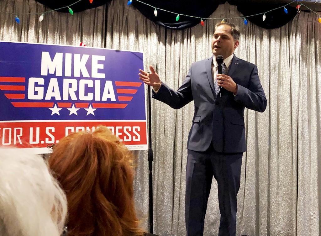 In this Tuesday, Jan. 28, 2020, photo, 25th District congressional candidate and former Navy combat pilot Mike Garcia addresses supporters in Simi Val...