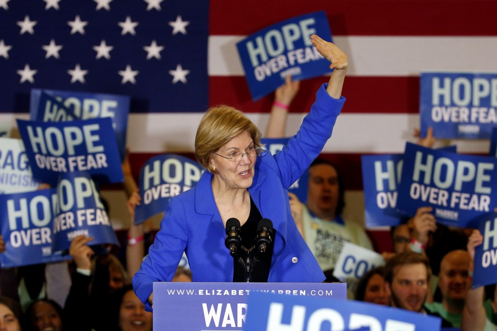 Democratic presidential candidate Sen. Elizabeth Warren, D-Mass., speaks to supporters at a caucus night campaign rally Monday, Feb. 3, 2020, in Des M...