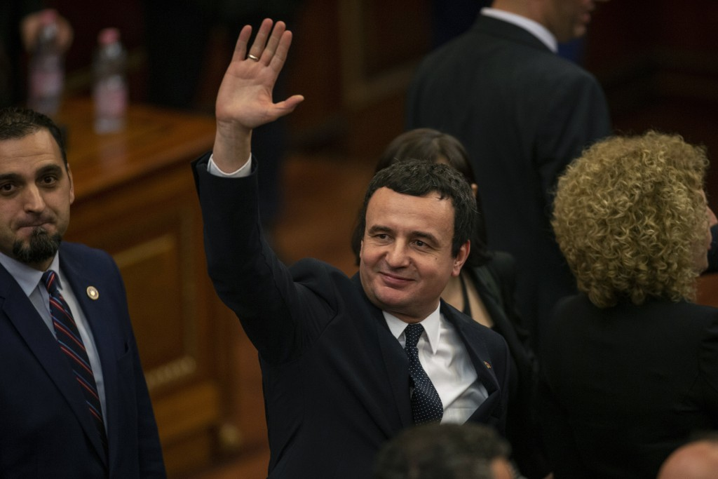 Albin Kurti, the newly elected prime minister of Kosovo waves after a new government was elected, in the capital Pristina, Monday, Feb. 3, 2020.  Koso...