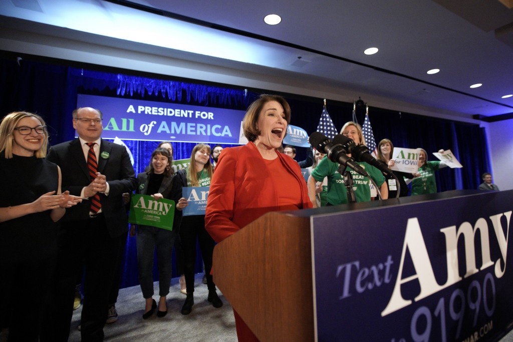 Democratic presidential candidate Sen. Amy Klobuchar, D-Minn., speaks to supporters as she is accompanied by her husband John Bessler, second left, an...