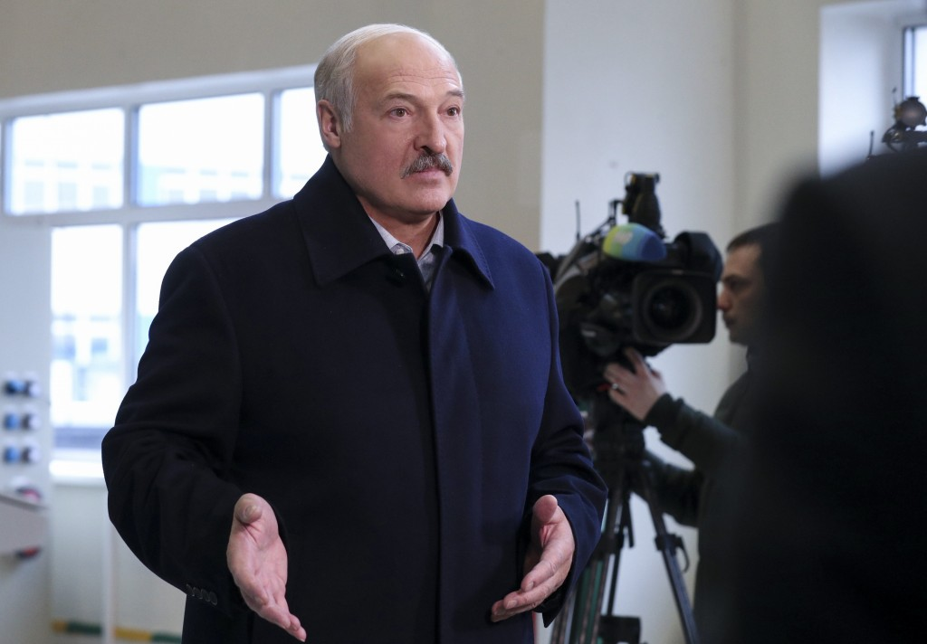 Belarusian President Alexander Lukashenko speaks to journalists as he visits the Dobrush Paper Factory in Dobrush, Belarus, Tuesday, Feb. 4, 2020. Luk...