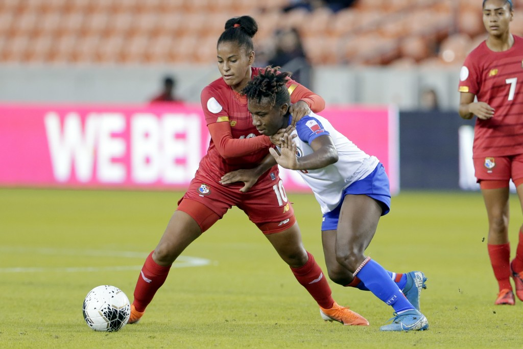 Panama midfielder Aldrith Quintero (10) grabs Haiti midfielder Melchie Dumonay (6) as they chase the ball during the first half of a CONCACAF women's ...