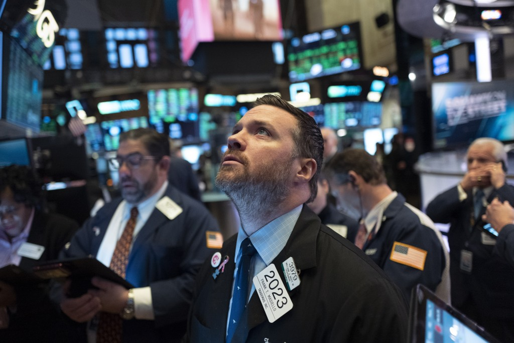 Stock trader Frank Masiello works at the New York Stock Exchange, Tuesday, Feb. 4, 2020. Stocks are opening broadly higher on Wall Street, following g...
