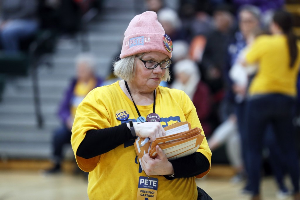 Elizabeth Hendrix of Des Moines, Iowa, precinct captain for Democratic presidential candidate former South Bend, Ind., Mayor Pete Buttigieg, carries P...