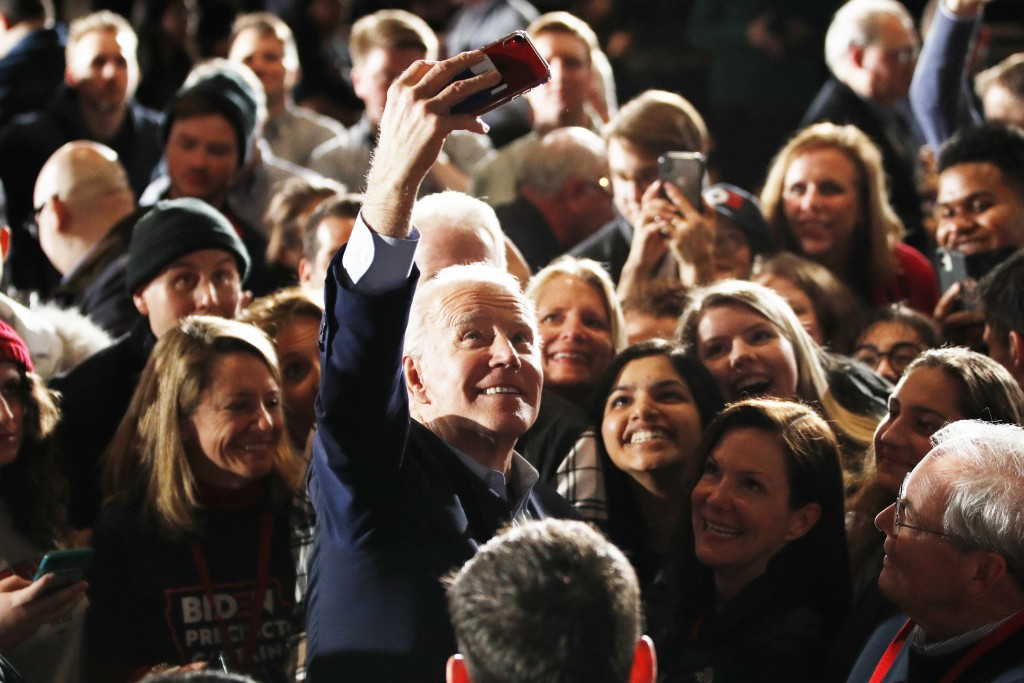 Democratic presidential candidate former Vice President Joe Biden walks in the crowd at a caucus night campaign rally on Monday, Feb. 3, 2020, in Des ...