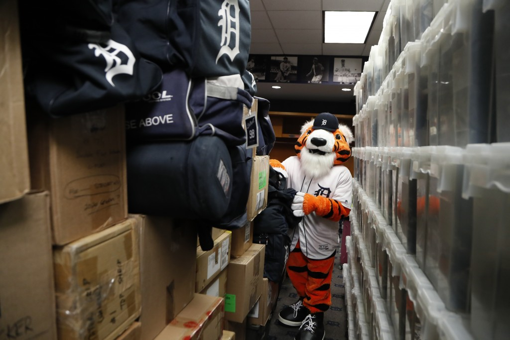 Paws, the Detroit Tigers mascot, helps load equipment at Comerica Park in Detroit, Monday, Feb. 3, 2020 in preparation for the move to Lakeland, Fla.,...