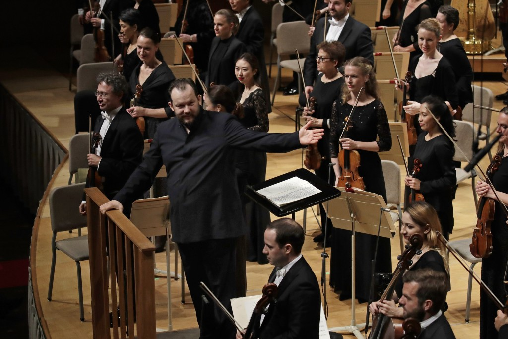 FILE - In this Oct. 31, 2019, file photo, Andris Nelsons gestures towards the musicians prior to conducting a joint concert of the Boston Symphony Orc...