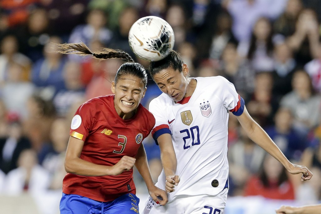 Costa Rica defender Maria Coto (3) and United States forward Christen Press (20) both go for a header during the second half of a Concacaf women's Oly...