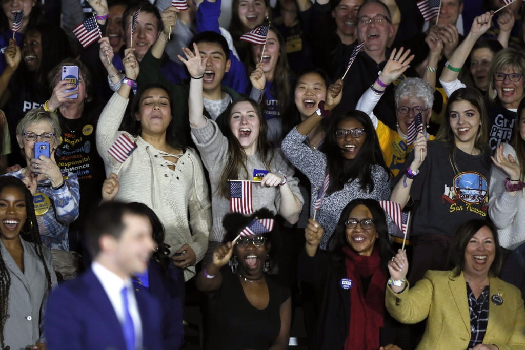 Supporters react as Democratic presidential candidate former South Bend, Ind., Mayor Pete Buttigieg speaks at a caucus night campaign rally, Monday, F...