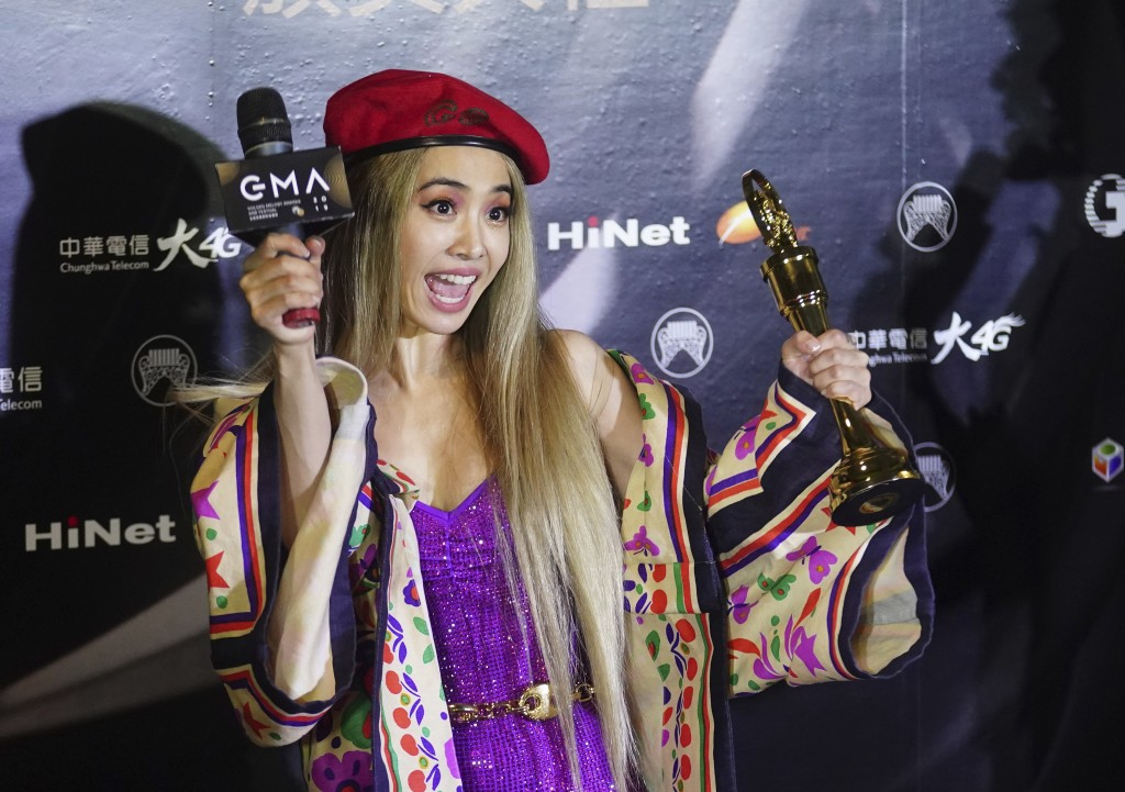 FILE - In this June 29, 2019, file photo, Taiwanese singer Jolin Tsai cheers for her awards of the Song of the Year and Album of the Year at the 30th ...