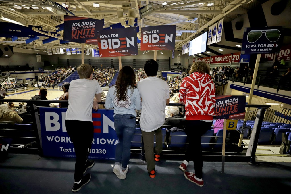Younger caucus goers hold signs for Democratic presidential candidate former Vice President Joe Biden at the Knapp Center on the Drake University camp...