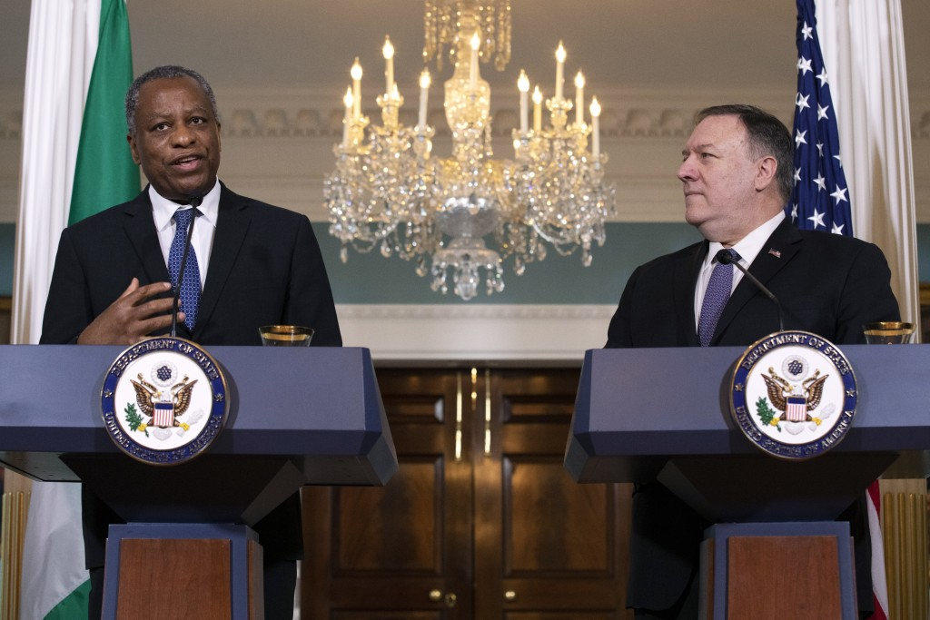 Nigeria's Minister of Foreign Affairs Geoffrey Onyeama, left, speaks next to Secretary of State Mike Pompeo, Tuesday, Feb. 4, 2020, at the State Depar...