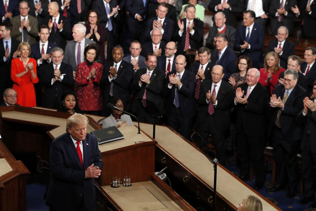 President Donald Trump walks from the podium after he delivered his State of the Union address to a joint session of Congress on Capitol Hill in Washi...